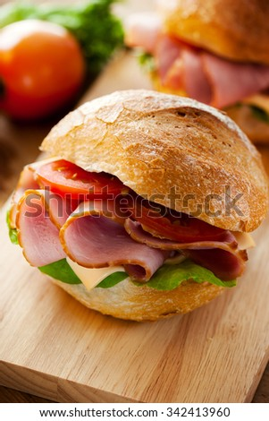 roll bread and ham sandwich for meal - stock photo