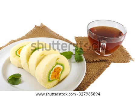 Roll cake thai dessert  and tea cup on white background