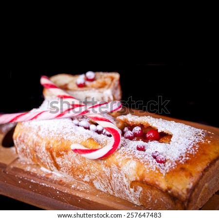 Roll cake with jam and cranberries