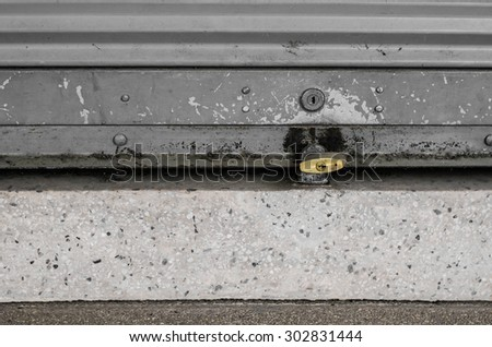 roll garage gate is closed and locked - stock photo
