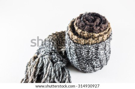Roll knitted scarf on a white background.