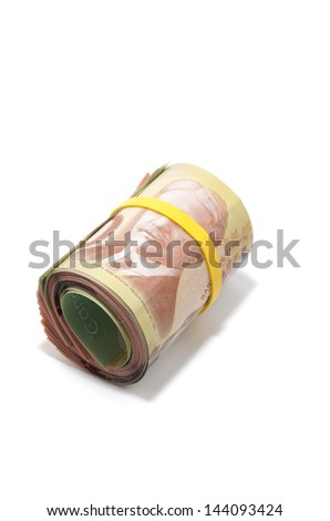 Roll of bank notes with yellow plastic band over the eyes - stock photo