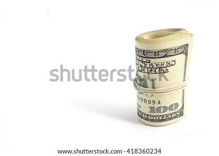 roll of bills on one hundred dollars. - stock photo