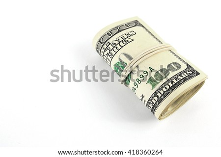 roll of bills on one hundred dollars - stock photo