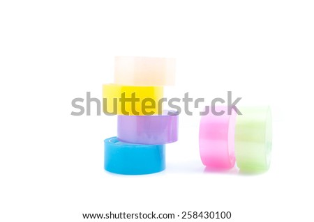 Roll of colorful cellophane tape isolated on white background. - stock photo