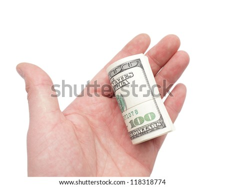 roll of dollars in hand. Isolated on white.