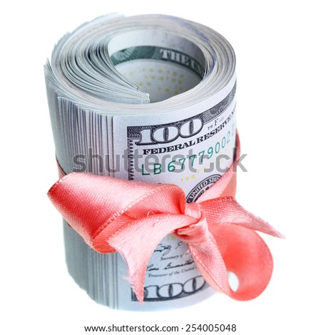 Roll of dollars with ribbon and bow - stock photo