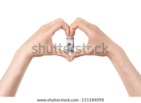 Roll of dollars with the heart  made of two women hands. love money concept - stock photo