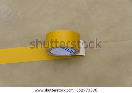 roll of double sided tape on the vapor barrier for the waterproofing of a roof - stock photo