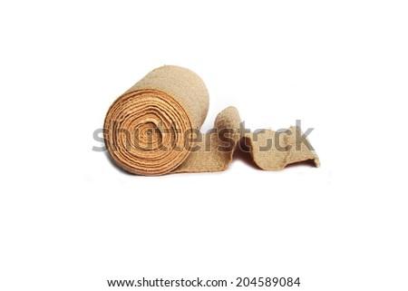 Roll of Elastic Bandage on White Background - stock photo