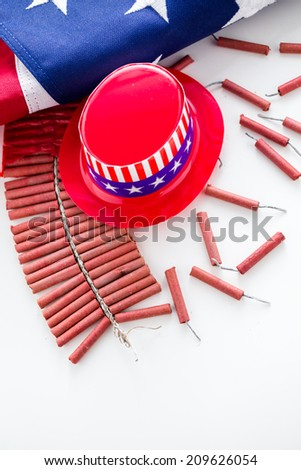 Roll of firecrackers with American flag on a white background.