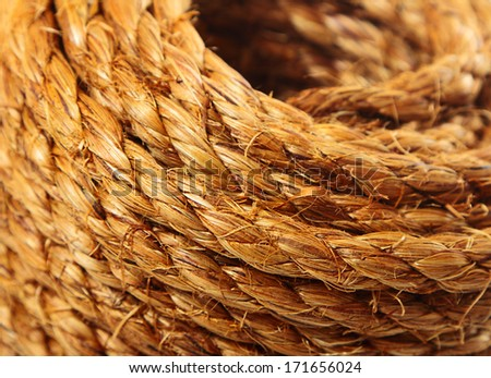 Roll of hemp rope close up background - stock photo