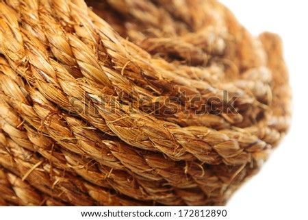 Roll of hemp rope on pure white background