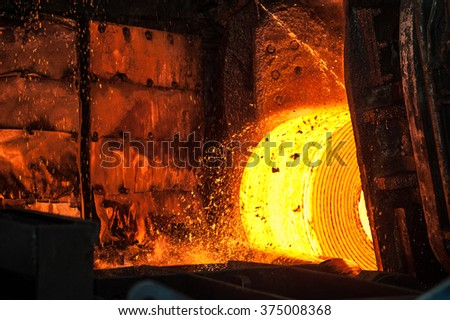 Roll of hot metal on the conveyor belt - stock photo