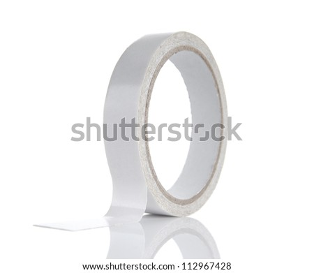 Roll of light gray adhesive tape isolated on white background - stock photo