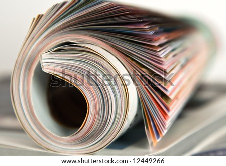Roll of magazine on isolated white background
