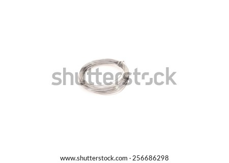 Roll of metal wire on White Isolated background - stock photo