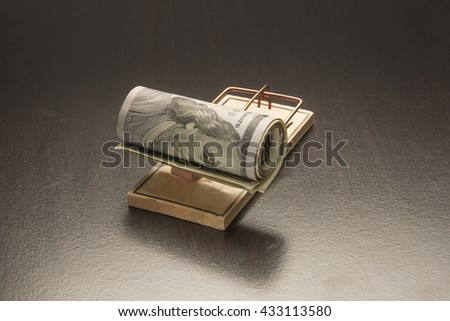 Roll of money on a mouse trap/Money trap/Roll of money is trapped - stock photo