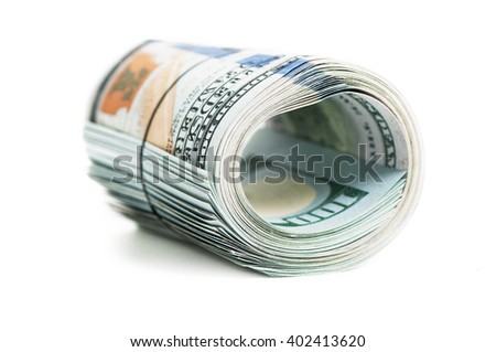 Roll of new one hundred dollars on white background