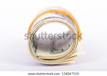 Roll of one hundred dollar banknotes, isolated on white background. - stock photo