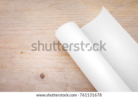 Roll paper on wood table background stock photo 761131678 roll of paper on wood table background engineer blueprint for draft work blank document malvernweather Image collections
