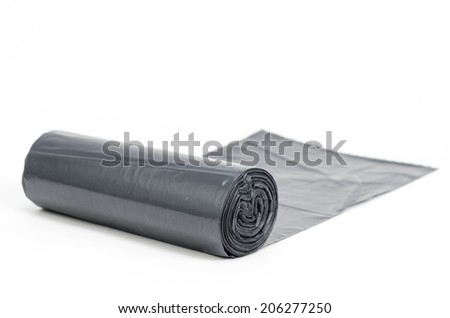 Roll of plastic garbage bags isolated on white - stock photo