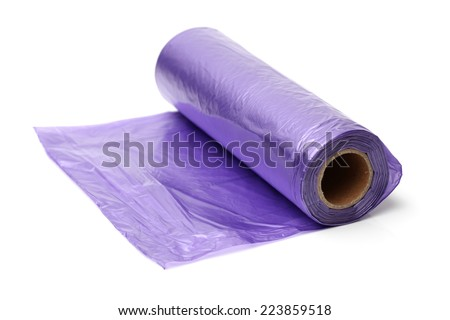 Roll of plastic garbage bags on white background