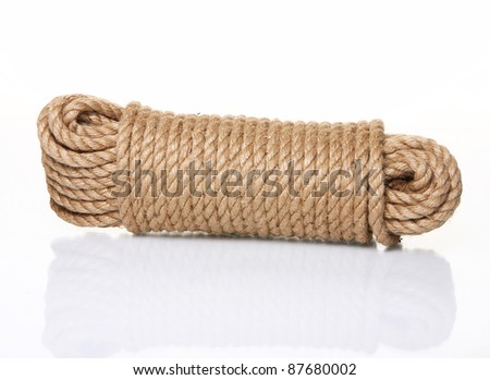Roll of rope over white background - stock photo