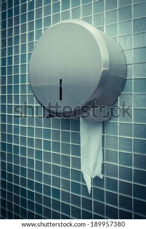 roll of toilet paper in a stainless steel holder - stock photo