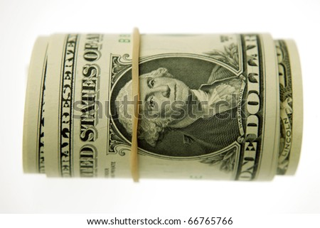 Roll of U.S. banknotes rolled up on white background - stock photo