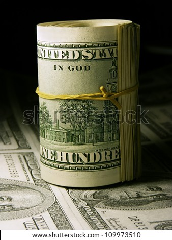 Roll of US dollars - stock photo