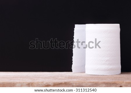 Roll of White Tissue Paper on Black Background.