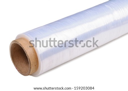 Roll of wrapping plastic stretch film. Close-up with selective focus and Shallow Depth of Field. Isolated on white background. - stock photo
