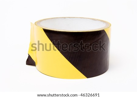 Roll of yellow and black high visibility tape isolated against white background.