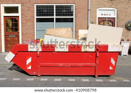 roll-off dumpster filled with building rubble - stock photo