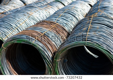 Roll off thick steel fitting, steel background. - stock photo