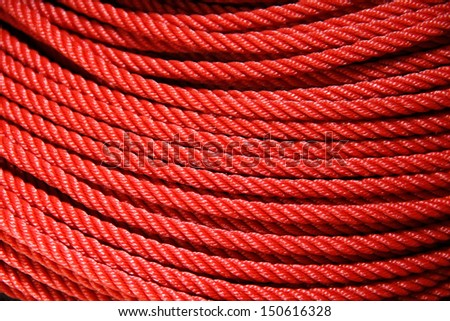 roll texture of red nylon rope - stock photo