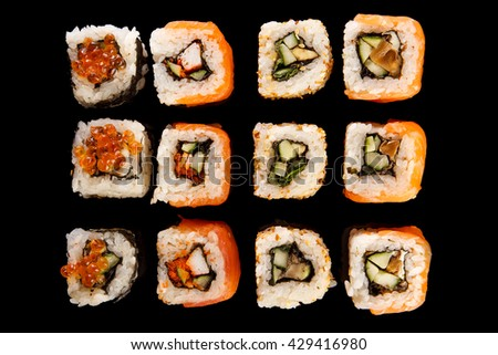 Roll the delicious sushi on a black background.