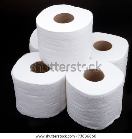 roll tissue paper on black background - stock photo
