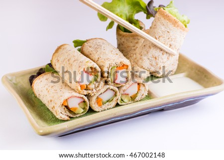 Roll whole wheat with fresh salad and carp stick
