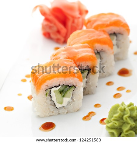 Roll with Cream Cheese and Cucumber inside. Salmon topped - stock photo