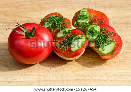 roll with tomatoes - stock photo