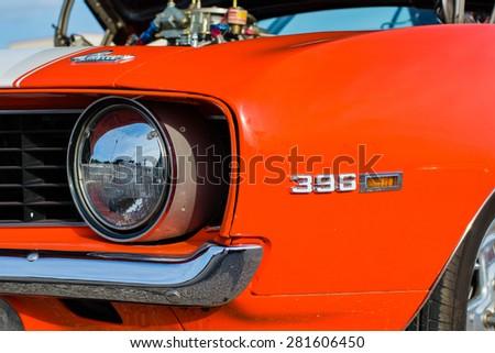 ROLLA, MISSOURI MAY 9, 2015 - Close up of Orange Camaro at Rolla Cruise In Show - stock photo