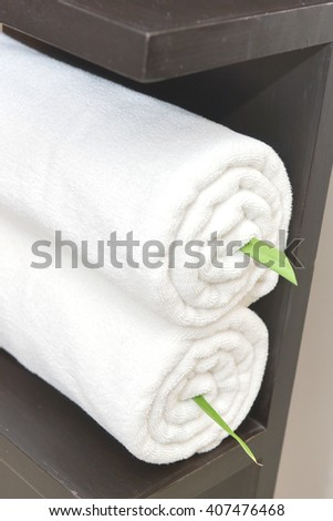 rolled bath towels at hotel spa - stock photo