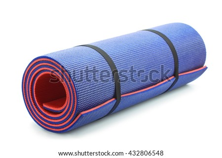 Rolled blue foam yoga mat isolated on white - stock photo