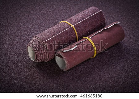 Rolled emery paper top view abrasive tools.