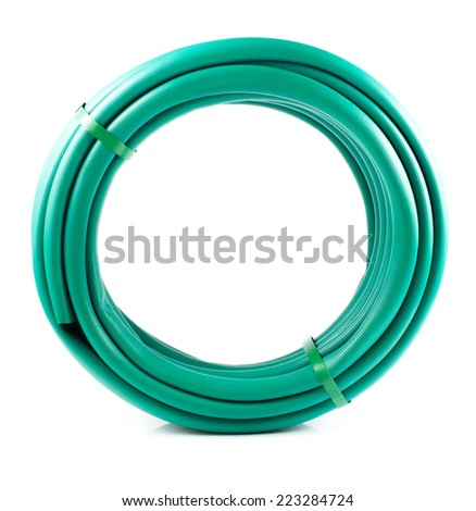 Rolled garden hose isolated on white - stock photo