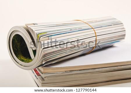 rolled magazine - stock photo