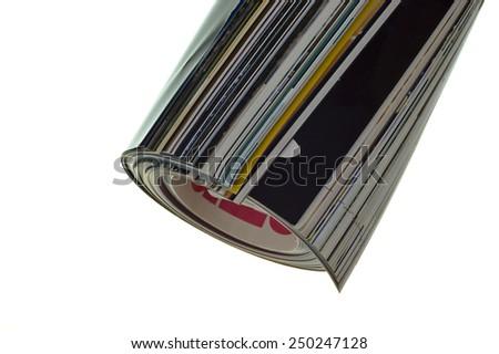 Rolled magazine isolated on white background - stock photo