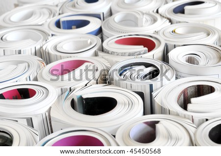 Rolled magazines - stock photo